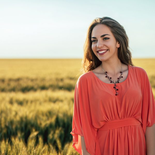 Attractive young woman standing outside in the field